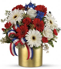 Here's to You by Teleflora - Brilliant blue hydrangea, yellow roses, red gerberas and miniature carnations, yellow button spray chrysanthemums are delivered .